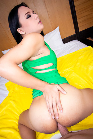 Ladyboy Bon perishable body is buried in tight green dress.