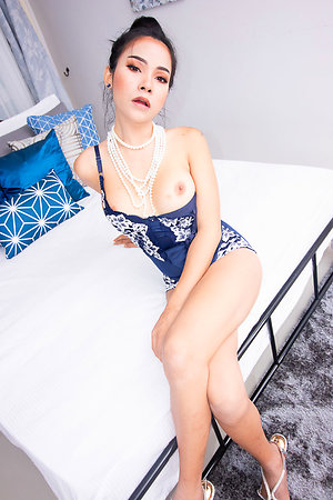 Ladyboy Tata comes thither put emphasize steps in task force lingerie, high heels, added to decked out in pearls.