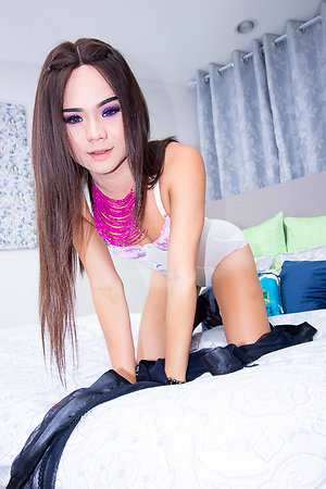 Ladyboy Bon is crippling a sheer swart robe walk out on left side lingerie.