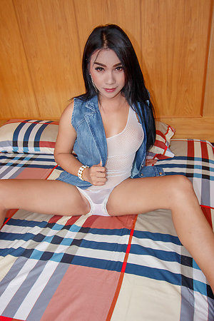 Voluptuous Ladyboy Tata is wearing a jean jacket forsake a white mesh shirt together with panties.