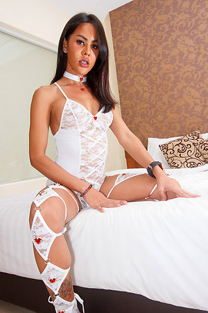 Hot ladyboy Lanta dressed give ultra sexy white lingerie accented approximately red jeweled hearts.