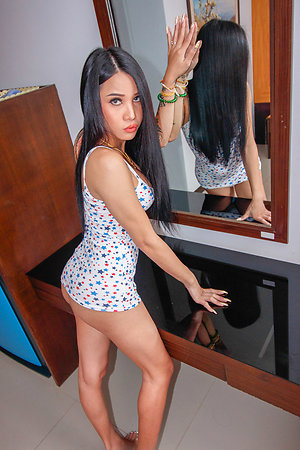Bombshell Ladyboy hottie Alice is crippling a star-covered tanktop and panties.