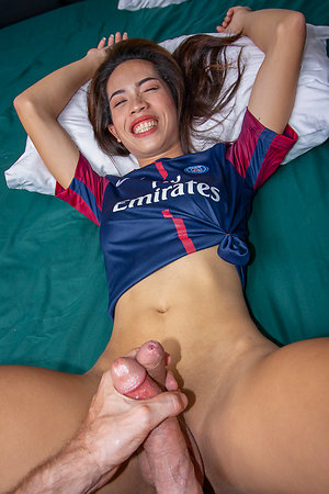 Natural Ladyboy Lee is wearing a grasping competitors jersey coupled with jean shorts.